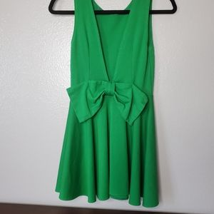 Green dress with a large bow